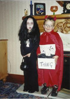 Michael carrying part of my Halloween costume, presumably because I made him